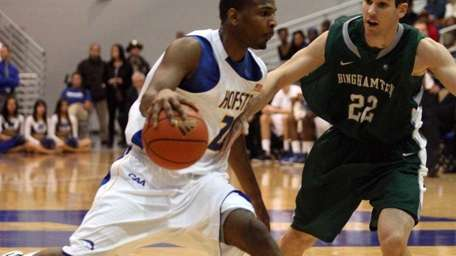 Hofstra's #23 Mike Moore drives the ball past