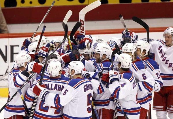 New York Rangers players swarm teammate Brad Richards,