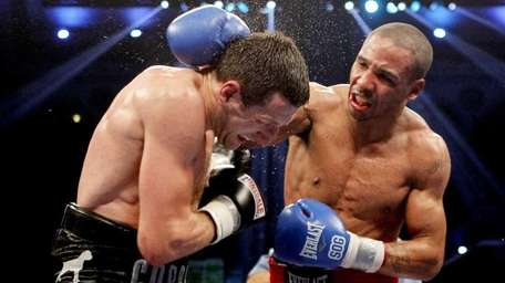 Andre Ward, right, connects with a right punch
