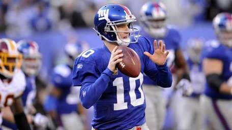 Eli Manning looks to throw during the first