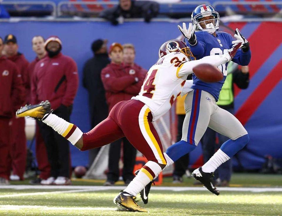 Byron Westbrook of the Washington Redskins breaks up
