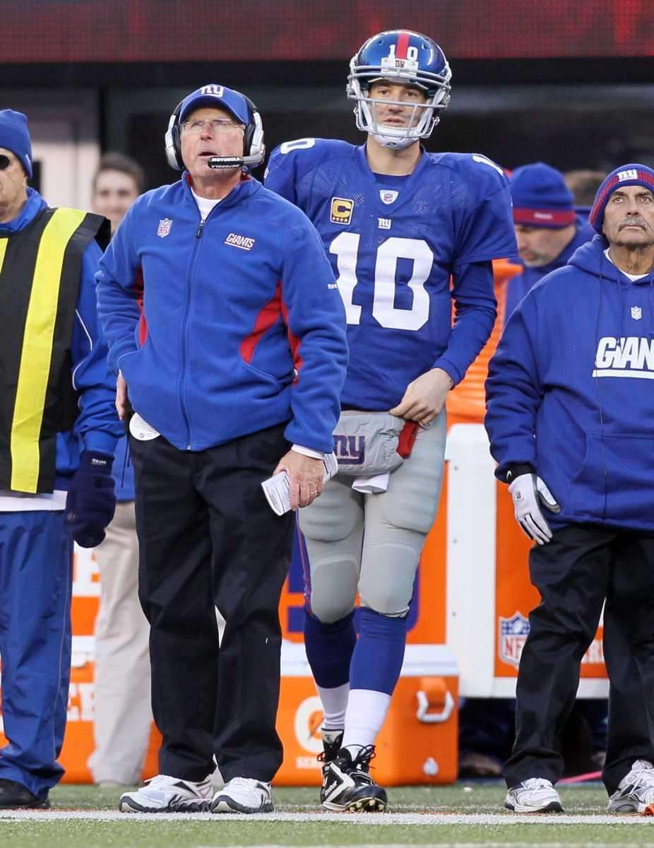 Eli Manning and head coach Tom Coughlin of