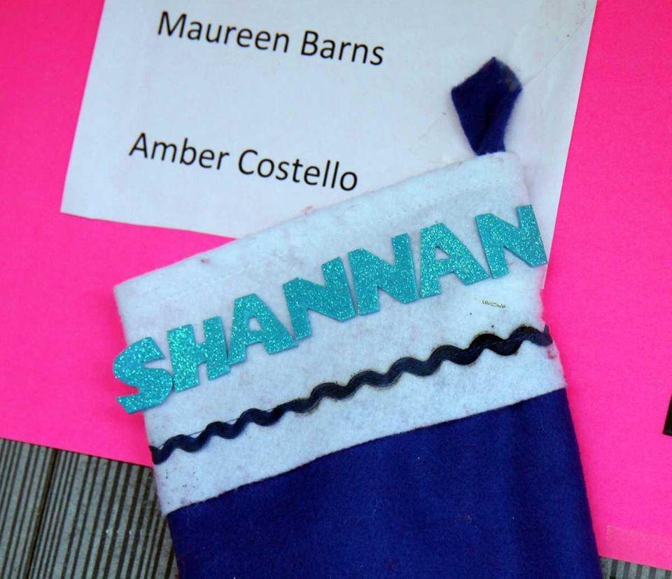 A Christmas stocking of Shannan Gilbert hangs on