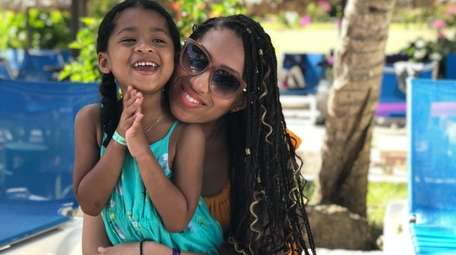 Briana Richards, 29, of Baldwin, with her daughter