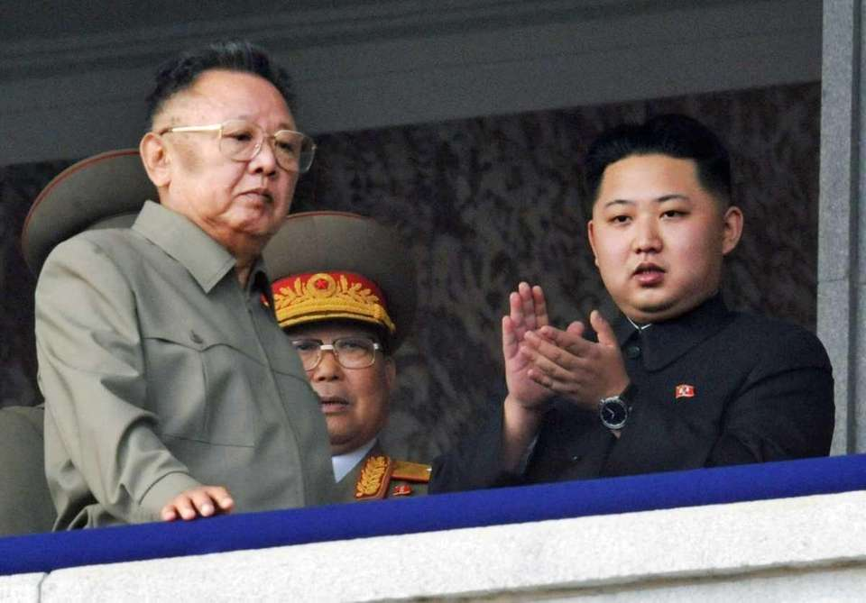 Kim Jong Un, right, along with his father