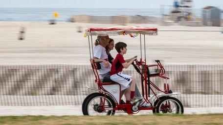Folks enjoy a ride around Jones Beach on