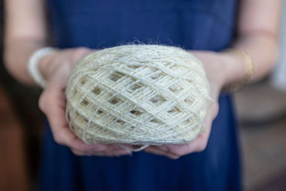 Stephanie Pinerio holds a ball of yarn wound