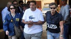 An FBI agent and an Italian law enforcement