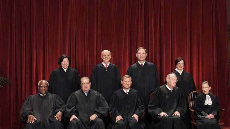 In this Oct. 8, 2010, photo, the justices