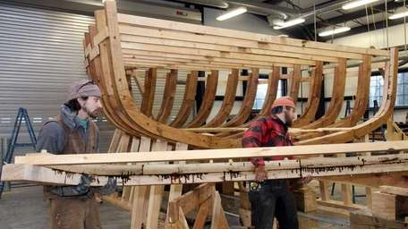 Andrew Nencheck of Maine carries a completed frame