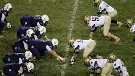 The Navy Midshipmen offense lines up against the