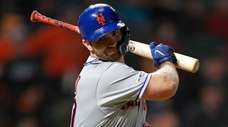 Mets first baseman Pete Alonso tosses his bat