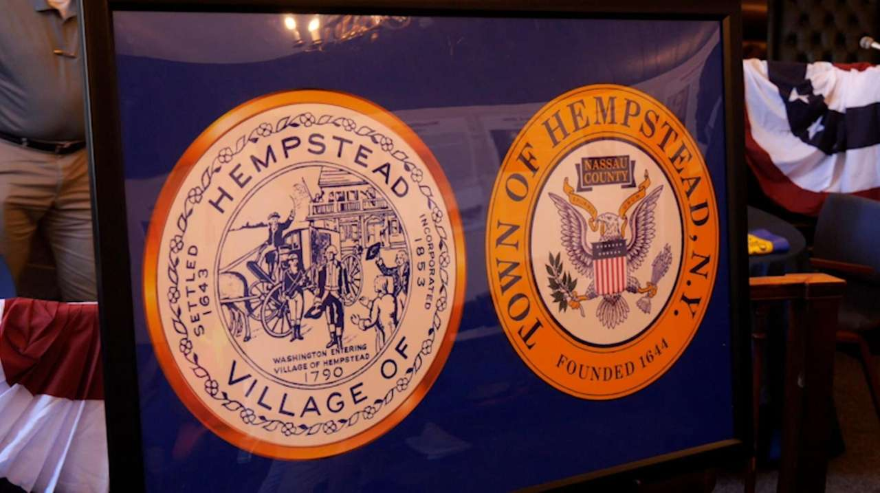 Hempstead Village Mayor Don Ryan presented a plaque