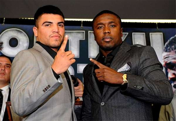 Victor Ortiz (L) poses with Andre Berto at