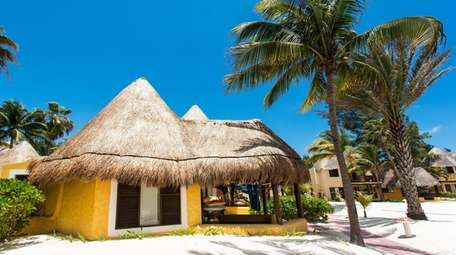 The palapa-style accommodations at Mahekal Beach Resort features
