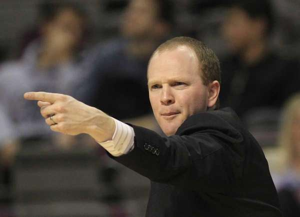 Detroit Pistons head coach Lawrence Frank signals from