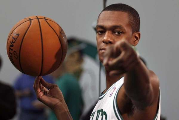 Boston Celtics guard Rajon Rondo jokes with photographers