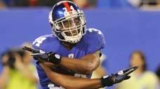 Deon Grant signals no touchdown after the Giants