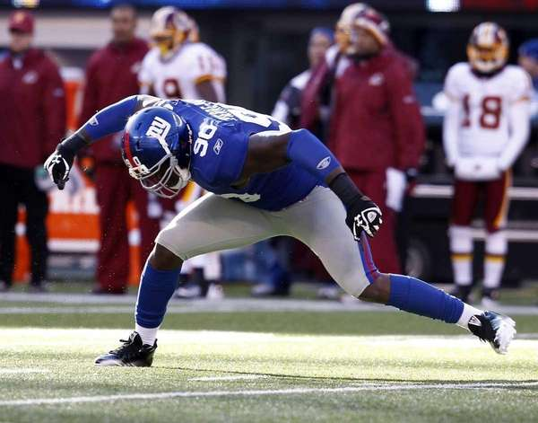 The Giants' Jason Pierre-Paul celebrates sacking Washington's Rex