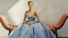 Model Jean Patchett wears a Hulitar gown in