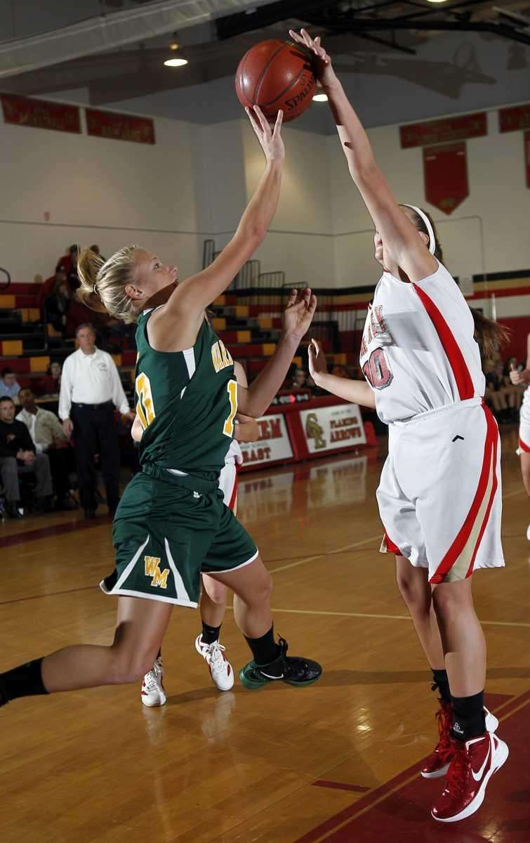 Sachem's Kathleen Everson (10) blocks the jump shot