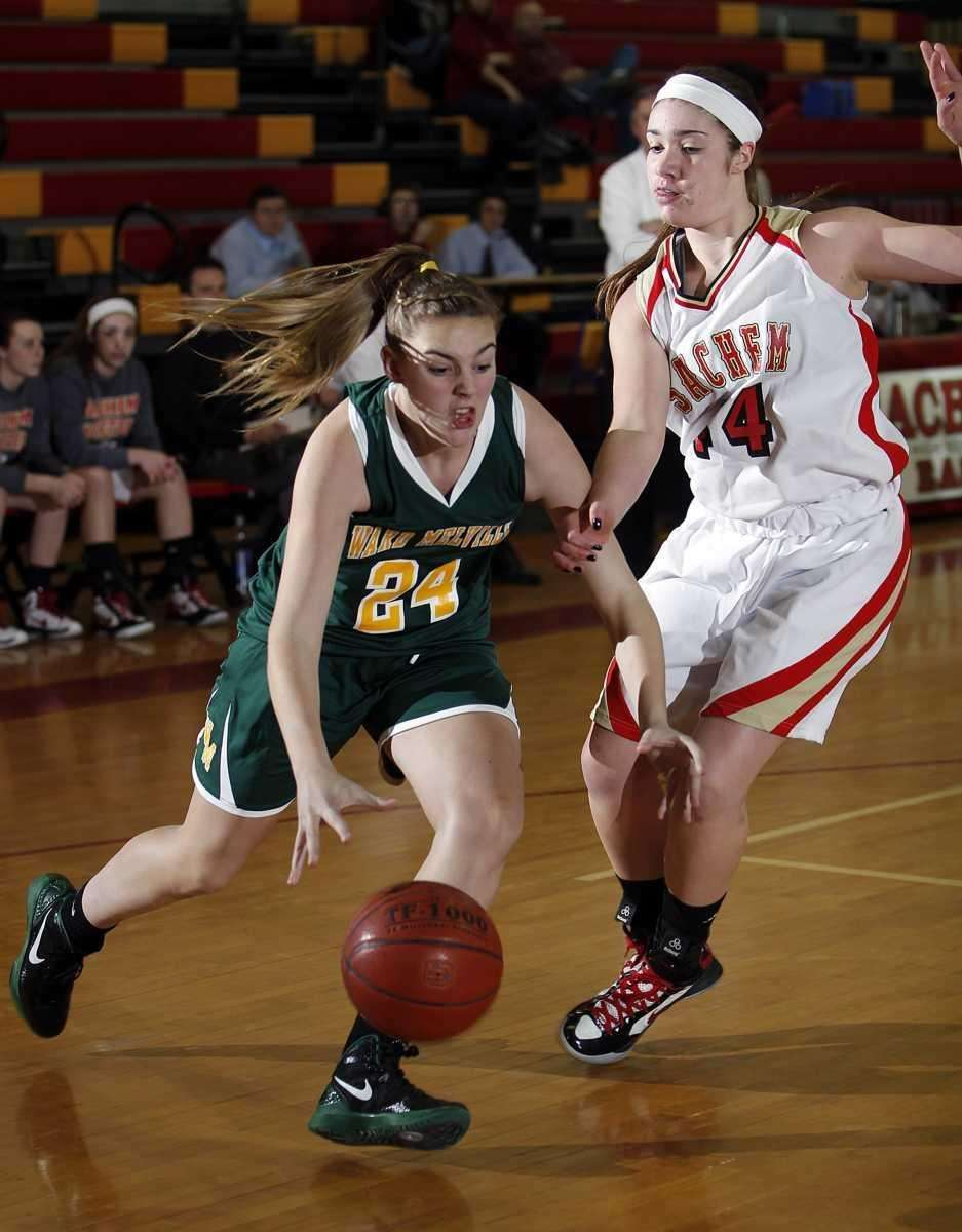 Ward Melville's Madison Gorman (24) drives against Sachem's
