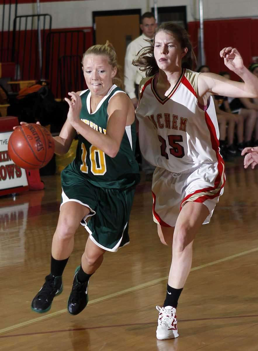Ward Melville's Kim Geiger (10) drives against Sachem's