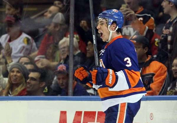 Travis Hamonic reacts to a play during a