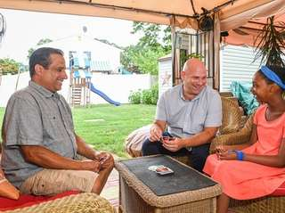 Jeffrey Pacheco and Paul MacMillan play UNO with