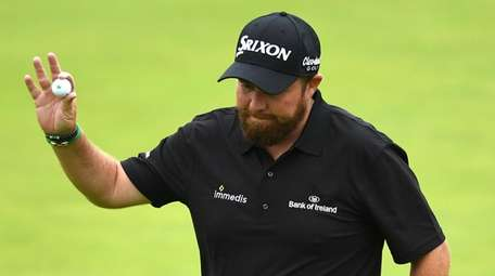 Ireland's Shane Lowry smiles as he finishes at