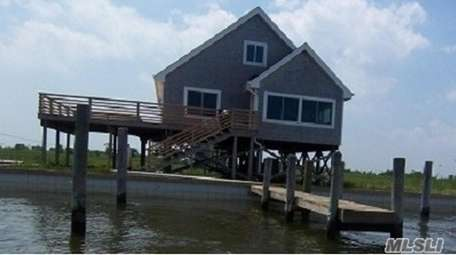 This Oak Island home is listed for $410,000.