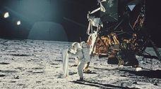 Lunar Module Pilot Edwin 'Buzz' Aldrin sets up