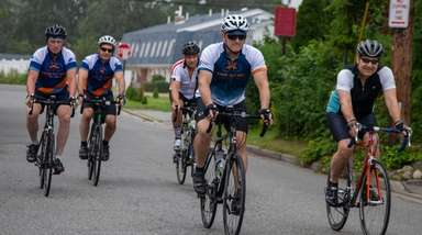 From left, cyclists Michael Simms, of Levittown; Steve