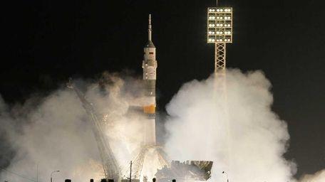 The Soyuz-FG rocket booster with Soyuz TMA-03M space
