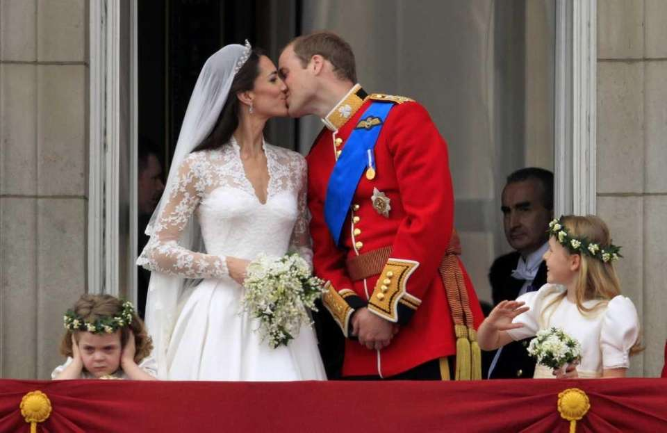Prince William kisses his wife Kate, Duchess of