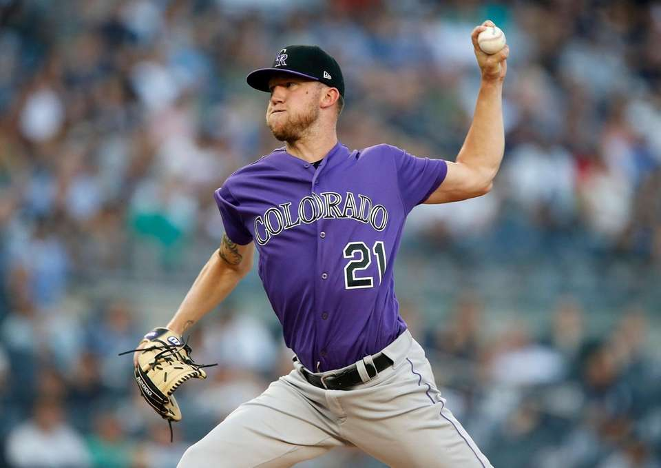 Kyle Freeland #21 of the Colorado Rockies pitches