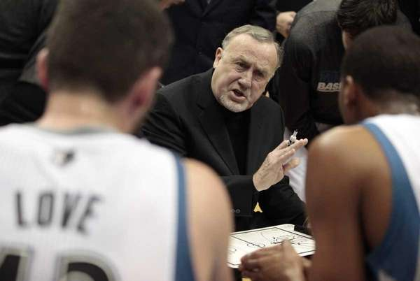 Minnesota Timberwolves head coach Rick Adelman, center, talks