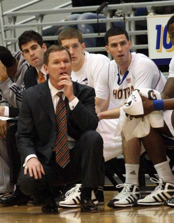 Hofstra's men's basketball head coach Mo Cassara watches
