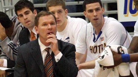 Hofstra's men's basketball head coach Mo Cassara watches
