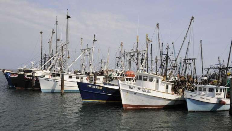 Commercial fishing vessels sit tied to the Shinnnecock