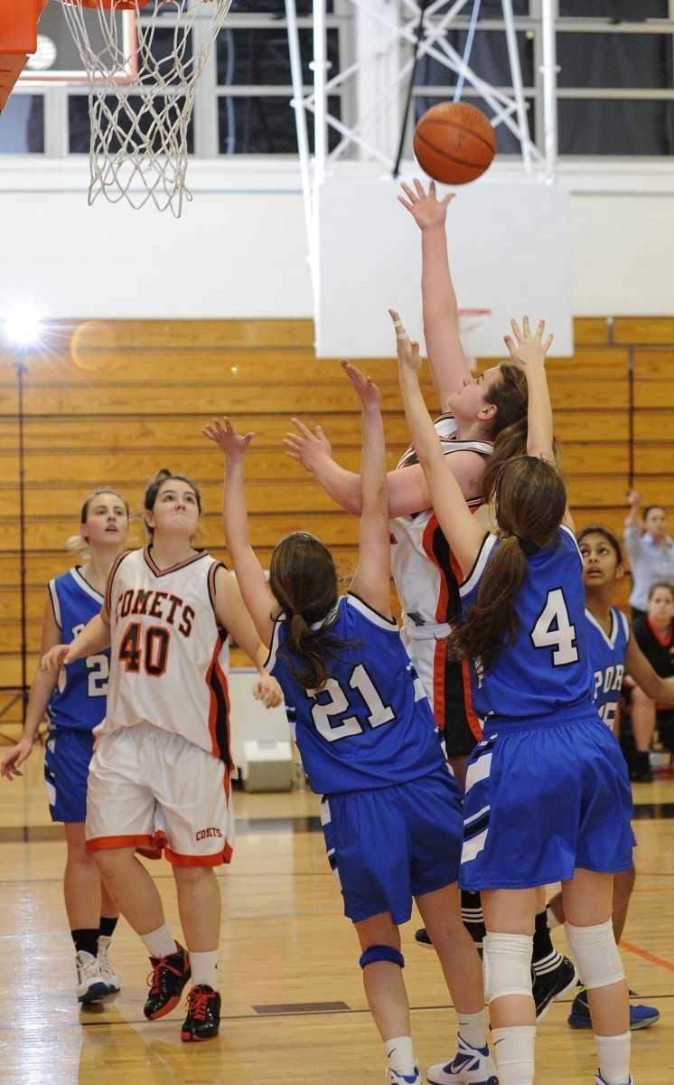 Hicksville's Caitlyn Garger makes the shot against Port