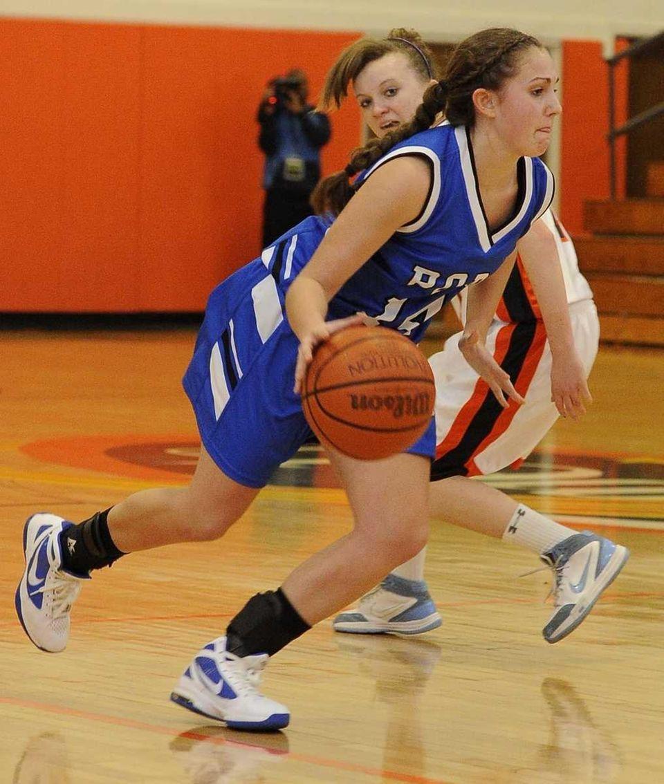 Port Washington's Arianna Gonzales drives the ball against