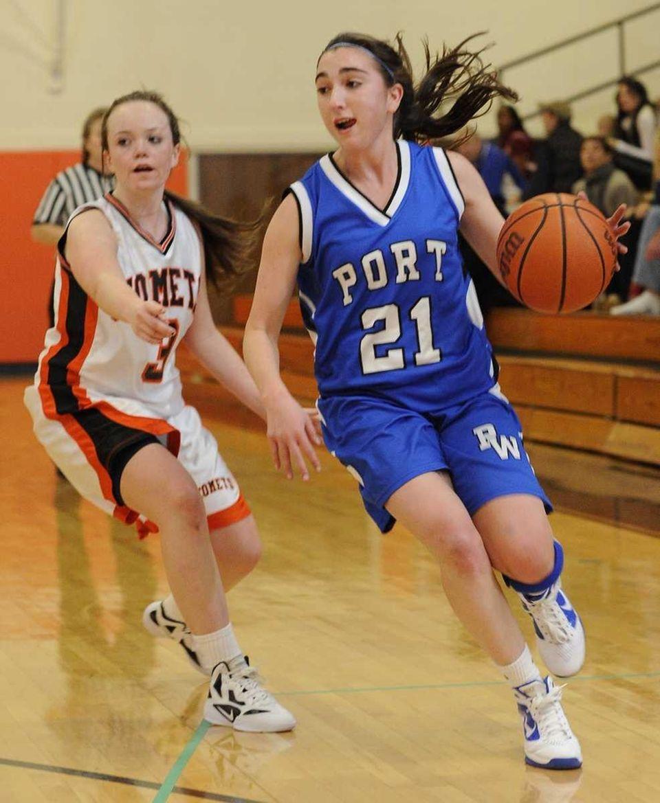 Port Washington's Emily Rosenthal drives the ball ahead
