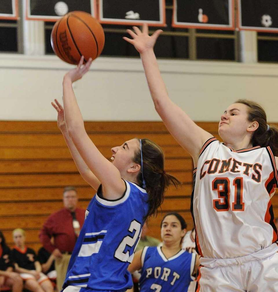 Port Washington's Emily Rosenthal goes up for a