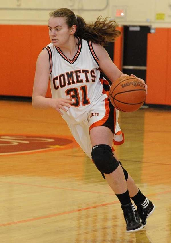 Hicksville's Caitlyn Garger drives the ball against Port