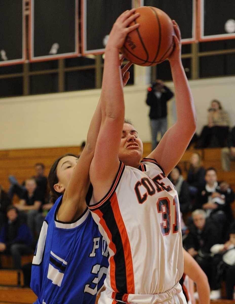 Hicksville's Caitlyn Garger pulls down a rebound against