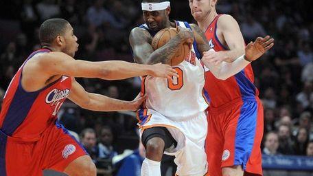 New York Knicks forward Larry Hughes driving between