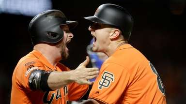 San Francisco Giants' Alex Dickerson, right, celebrates with