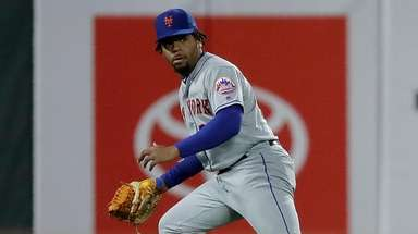 Mets left fielder Dominic Smith watches the game