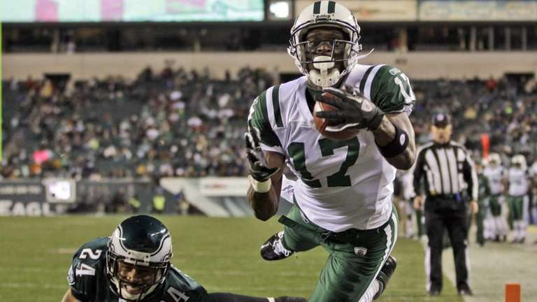 New York Jets wide receiver Plaxico Burress catches